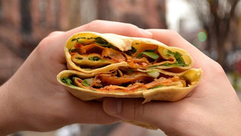 Jianbing is China's most popular breakfast street food. Photo via UnTour Food Tours.
