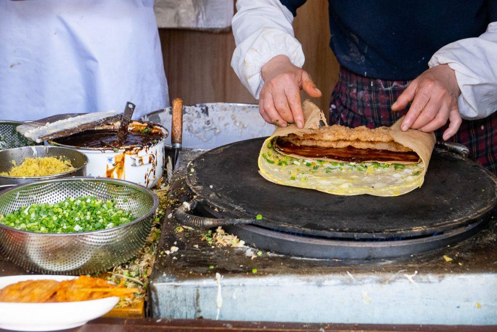 Jianbing is China's most popular breakfast street food. Taken in Shanghai. Photo by Rachel Gouk.