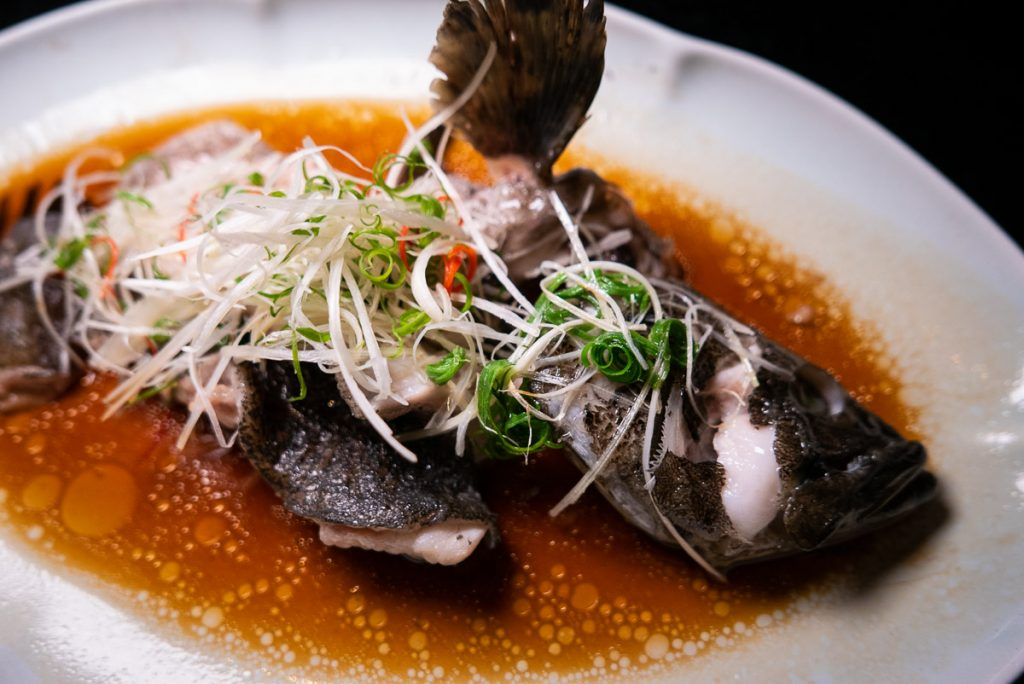 Steamed Grouper on the Chinese New Year Menu at Hakkasan Shanghai. Photo by Rachel Gouk.