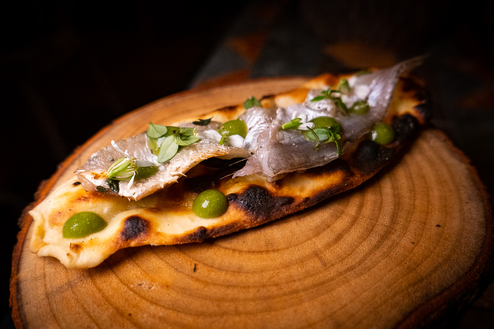Fermented naan bread with anchovies at Botanik, a seasonal, mostly plant-based sustainable restaurant in Shanghai. Photo by Rachel Gouk.