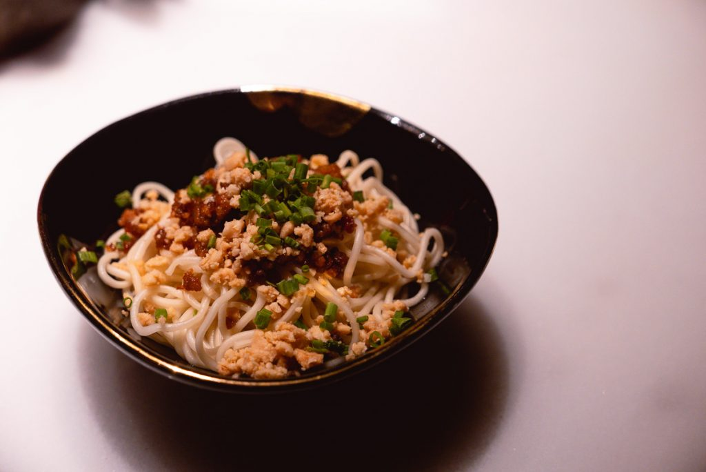 Dan Dan Mian noodles with minced pork, chili oil, crushed peanuts and scallions. Sichuan cuisine at The Peacock Room, a contemporary Chinese restaurant in Shanghai. Photo by Rachel Gouk