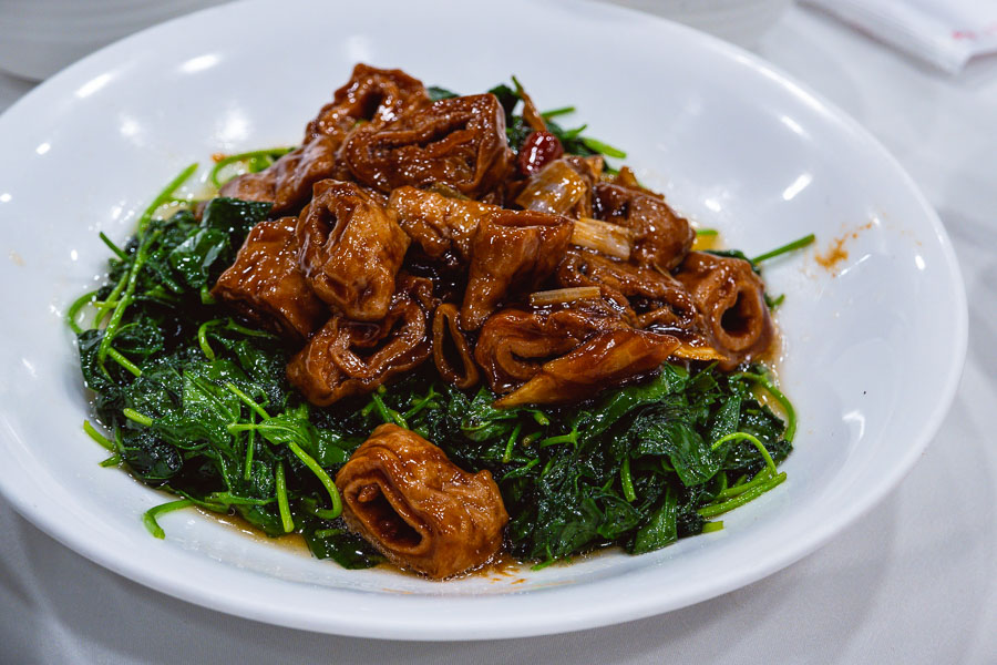 Braised intestines with caotou (clover), a hyper-Shanghainese dish. Where to eat Shanghainese food in Shanghai: Rui Fu Yuan, a restaurant in Xuhui district, Shanghai. Photo by Rachel Gouk @ Nomfluence.