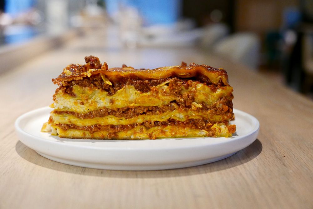 Food delivery options in Shanghai. Restaurants delivering comfort foods: Lasagna from Heritage y Madison. Photo by Rachel Gouk @ Nomfluence.