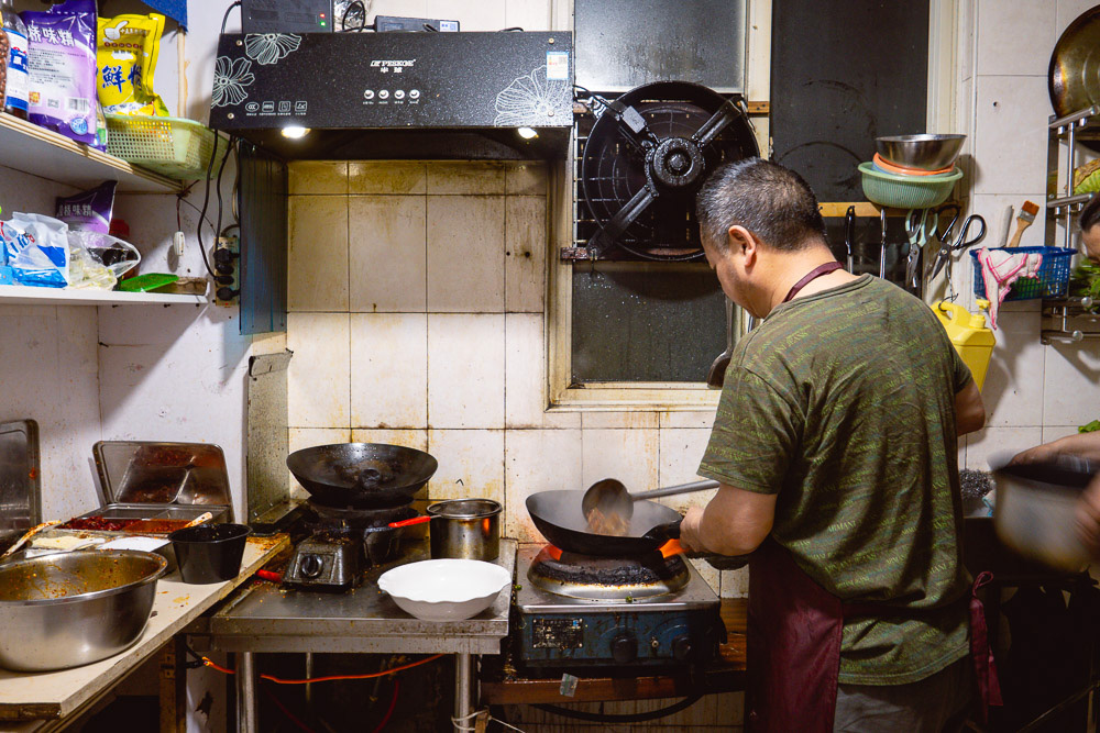 In the kitchen. La Wei Xian 辣味鲜 is a private kitchen serving authentic Sichuan food in Shanghai. Photo by Rachel Gouk @ Nomfluence.